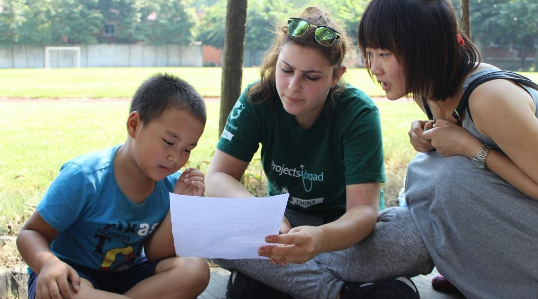 After learning Mandarin in China, a student volunteers at a local school, teaching English.